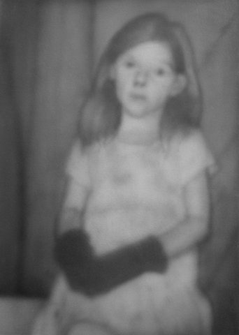 Little girl wearing black gloves
